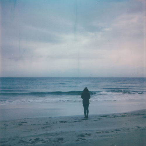 Analogue Photography Beach Beauty In Nature Cloud - Sky Film Photography Horizon Horizon Over Water Land Leisure Activity Lifestyles Men Motion Nature Outdoors People Polaroid Real People Rear View Scenics - Nature Sea Sky Water Autumn Mood