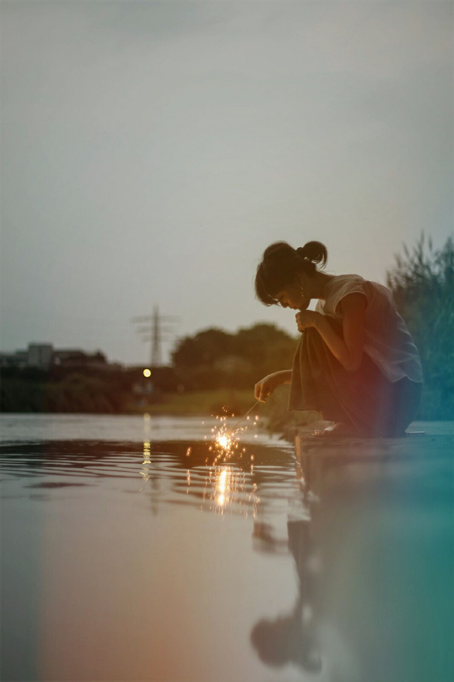 water, one person, real people, lifestyles, men, sky, nature, sunset, lake, childhood, beauty in nature, outdoors, day, people