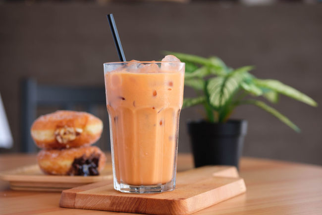 Food And Drink Drink Food Refreshment Straw Drinking Straw Table Glass Freshness Drinking Glass Household Equipment Indoors  Focus On Foreground Healthy Eating No People Wood - Material Close-up Still Life Ready-to-eat Smoothie Herb Breakfast Temptation Milk Tea