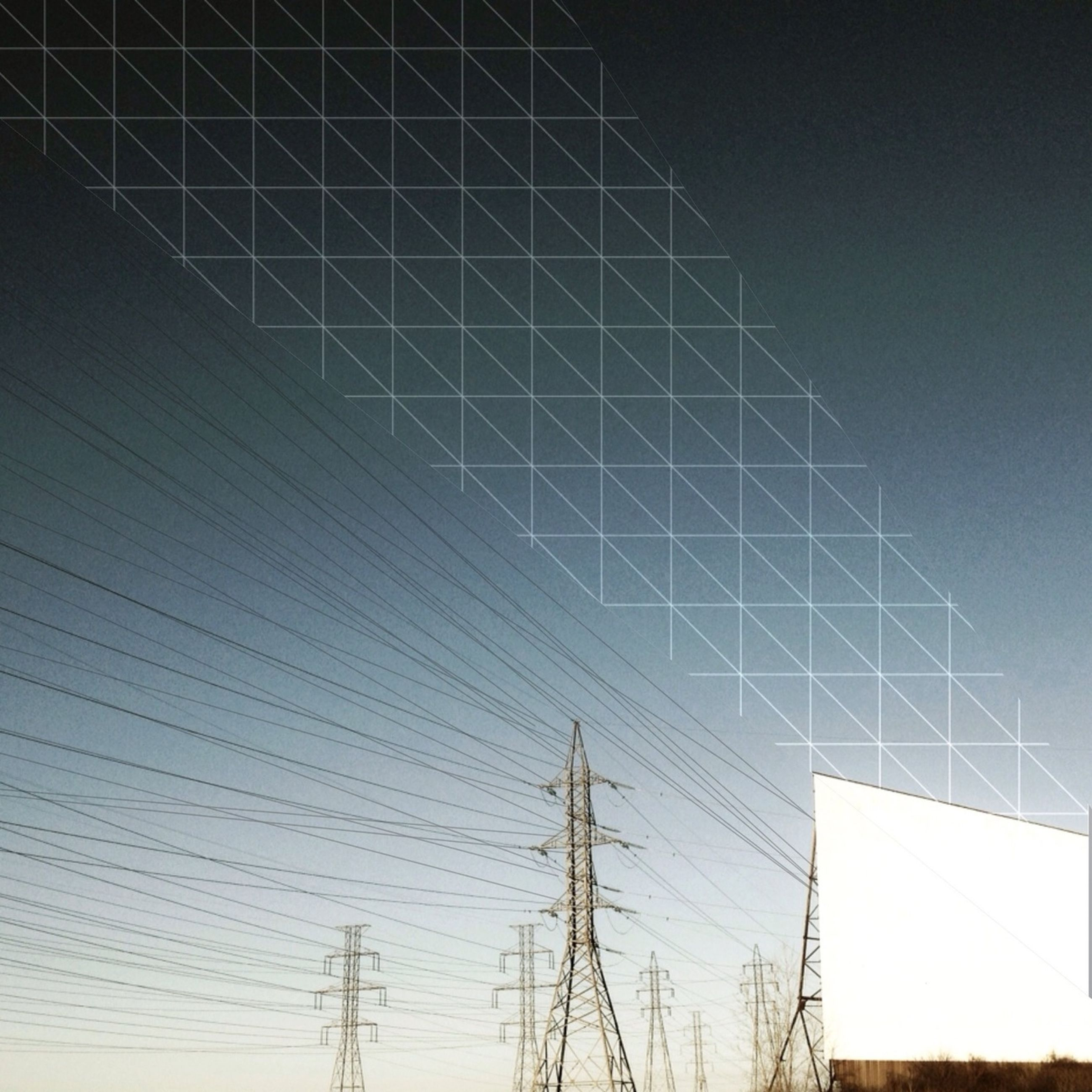 low angle view, power line, electricity, electricity pylon, power supply, fuel and power generation, connection, technology, cable, clear sky, sky, built structure, silhouette, no people, outdoors, blue, complexity, day, nature, architecture