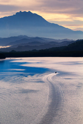 Mountain Beauty In Nature Scenics - Nature Mountain Range Sky Tranquil Scene Water Tranquility Cloud - Sky Nature Non-urban Scene Sunset Idyllic No People Waterfront One Animal Environment Remote Transportation Outdoors
