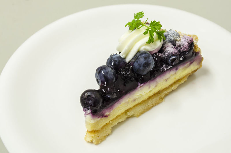Delicious Blueberry Cheese Pie Blueberry Blueberry Cheesecake Blueberry Pie Blueberrycheesecake Close-up Cream Day Dessert Food Food And Drink Food Styling Freshness Fruit Gourmet Indoors  Indulgence No People Plate Ready-to-eat Still Life Sweet Food Temptation Unhealthy Eating