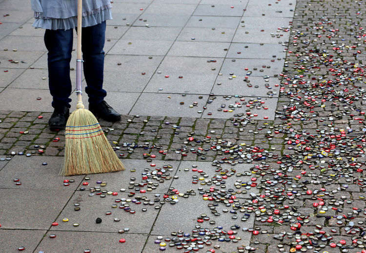 German tradition, sweeping with a broom in front of hamburg town hall on turning 30 year old