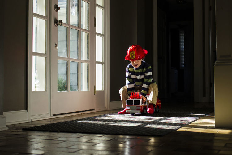 Boy sitting in toy at home
