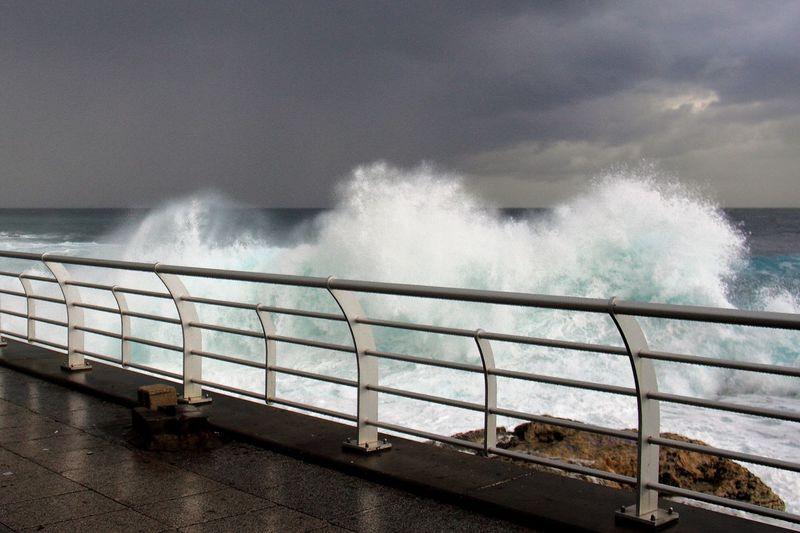 Water Power In Nature Force Crash Wave Sea Motion Breaking RISK Railing Crashing Beach Horizon Over Water