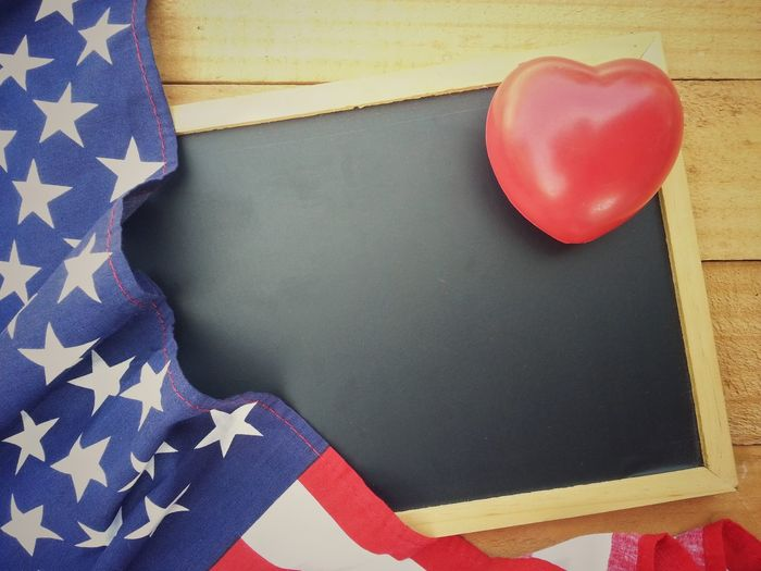 Red heart, blackboard and american flag on old wood table USA America Celebration Remember Memorial Flag Patriotism Independence Anniversary Memorial Day Event Nation Country Pride Peace Peaceful Holiday Memory Soldier Army Celebrate Greeting Cheerful Liberty 4th Of July