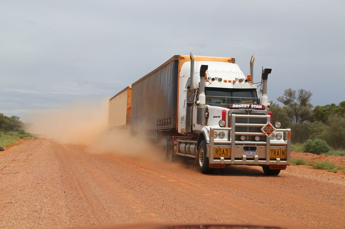 Australia Commercial Land Vehicle Driving Gravel Road Outback Outback Australia Outdoors Red Road Road Train Sky Speeding Transportation