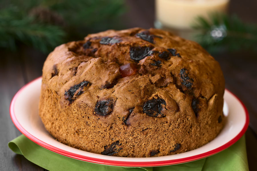 Traditional Chilean Pan de Pascua Christmas Cake made with spices, dried fruits and raisins, photographed with natural light (Selective Focus, Focus on the front of the cake) Breakfast Chile Chilean  Christmas Christmas Cake Holiday Horizontal Pascua  Raisin Baked Bread Cake Chilean Food Dessert Dried Fruit Food Food And Drink Pan Pan De Pascua Ready-to-eat Seasonal Snack Spice Sweet Sweet Food
