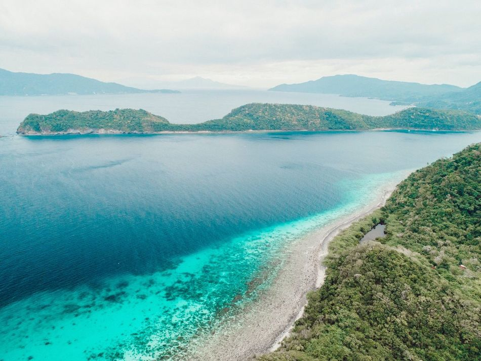 Batangas, Philippines Philippines Blue Island Batangas Ocean Sea Beauty In Nature Water Mountain Scenics Nature Tranquil Scene Tranquility Outdoors Sea Sky Day No People Mountain Range