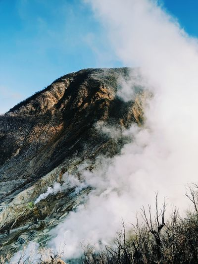 Volcanic mountain against sky. sulphuric fumes at owakudani valley