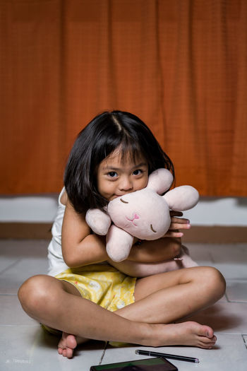 Portrait of cute boy with toy