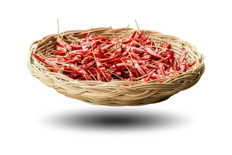Dried peppers in a wicker basket isolated on white background. White Background Food And Drink Food Studio Shot Freshness Indoors  Cut Out Raw Food Red Basket Container Vegetable Healthy Eating Wellbeing Dried Food Still Life No People Large Group Of Objects Copy Space Close-up Spaghetti Papper Chili  Chili Pepper Spicy