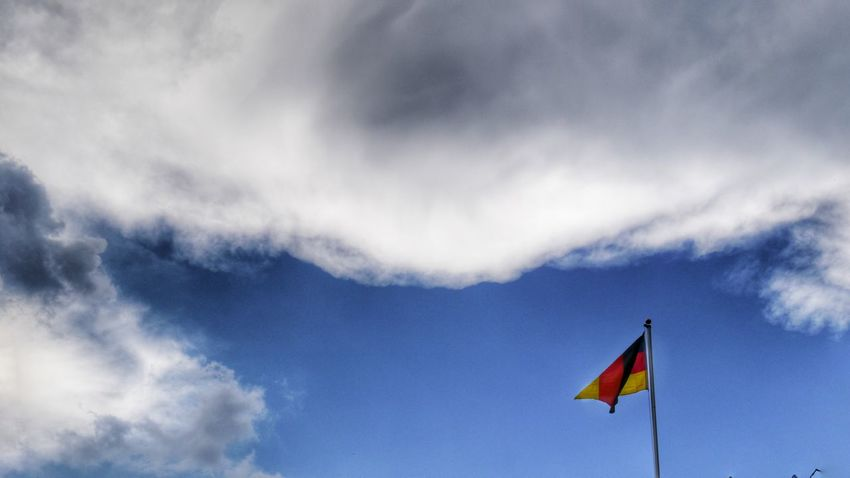 german flag in the blue sky with white clouds Nature Fine Art Eyem Gallery Sky And Clouds Sky Cloudy Flag Flags In The Wind  EyeEm Gallery White Clouds German Flag Black Red Gold Fine Art Photography Place Of Heart