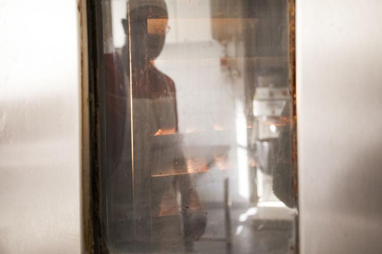 Reflection of man on door