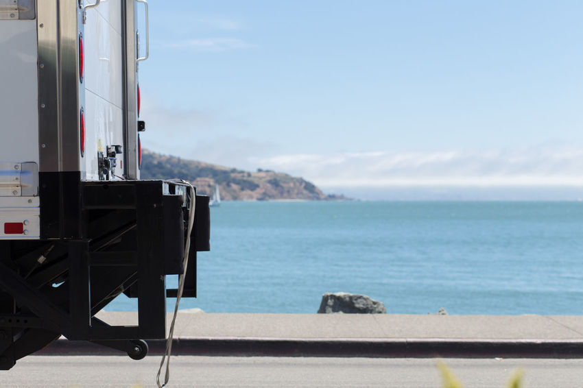 Trucking along Sausalito Bay frontm Miles Away Blue Finding New Frontiers Cloud - Sky Day Mountain Nature Traveling Observation Point Ocean Outdoors Remote Roads Scenics Sea Seascape Sky Tourist Resort Tranquil Scene Tranquility Transportation Truck Trucks Water Waterfront