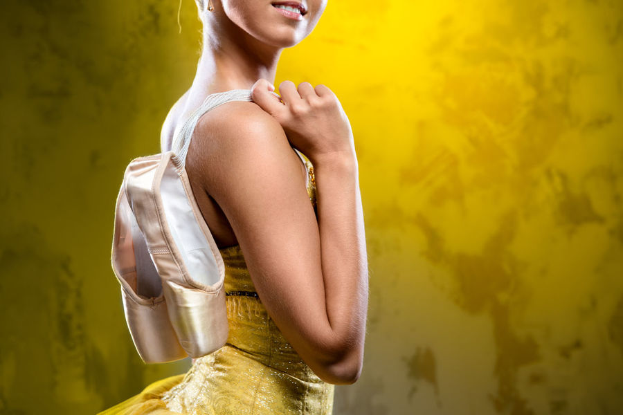 Ballerina with pointe shoes Alone Artist Ballerina Ballet Ballet Dancer Ballet Tutu Beautiful Woman Beauty Caucasian Choreography Dancer Female Girl Indoors  One Person Prima Professional Dancer Smile Smiling Studio Shot Woman Yellow