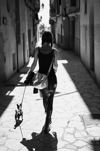 A Walk Architecture Building Exterior Built Structure Childhood Day Full Length Leisure Activity Lifestyles One Person Outdoors People Real People Rear View Shadow Sunlight Walking Women