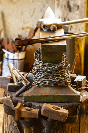 anvil with forging tools Anvil Close-up Craft Creativity Day Focus On Foreground Forging Forging Tools Hammers Metal Metal Industry Metallic No People Old Representation Rusty Still Life Wood - Material The Still Life Photographer - 2018 EyeEm Awards