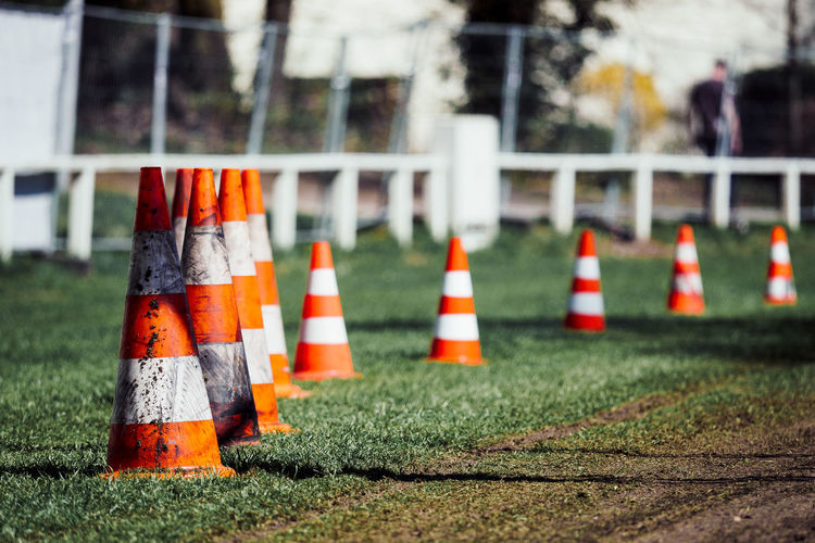 GENTLEMAN START YOUR ENGINES1 Vintageracedays Architecture Barrier Boundary Cone Day Focus On Foreground Grass In A Row Nature No People Orange Color Outdoors Plant Protection Race Racetrack Safety Security Selective Focus Sport Striped Traffic Cone