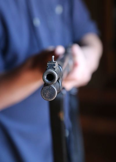 The wrong way to go about things.... Adults Only Close-up Day Focus On Foreground Gun Hands Up Don't Shoot Holding Human Hand Indoors  Men Midsection Mygunsareloaded Occupation One Man Only One Person People Shotgun Standing Weapon Wrong Way