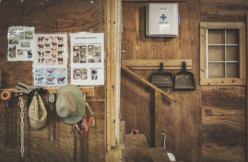Information sign and hats in barn