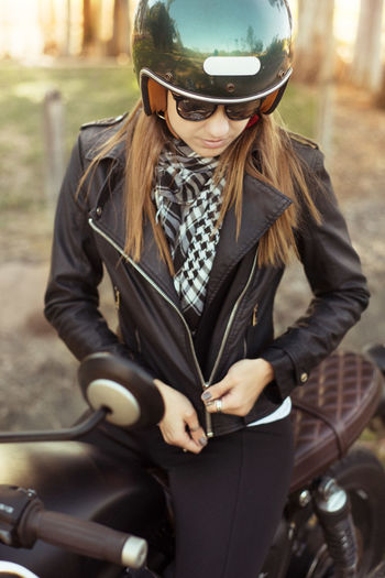 High Angle View Of Young Woman On Motorbike