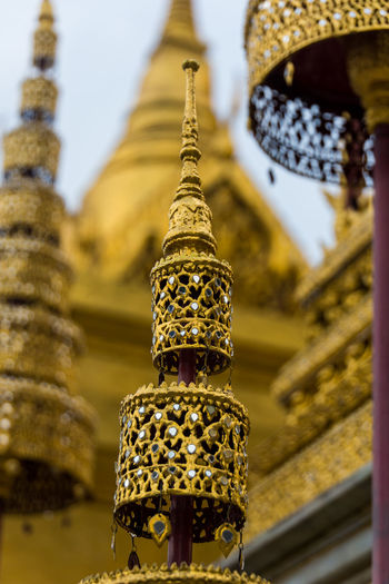 Wat Phra Kaeo Bangkok Wat Phra Kaeo Architecture Belief Building Building Exterior Built Structure Close-up Day Focus On Foreground Gold Colored History Metal No People Ornate Outdoors Place Of Worship Religion Spirituality The Past Travel Destinations