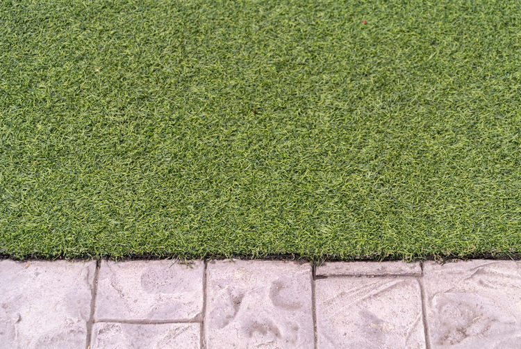 brick wall and grass. Backgrounds Close-up Concrete Day Environment Field Footpath Full Frame Grass Green Color Growth Hedge High Angle View Lawn Nature No People Outdoors Pattern Paving Stone Plant Textured  Turf Wall - Building Feature