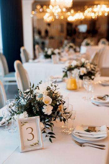 Flower vase on table at restaurant