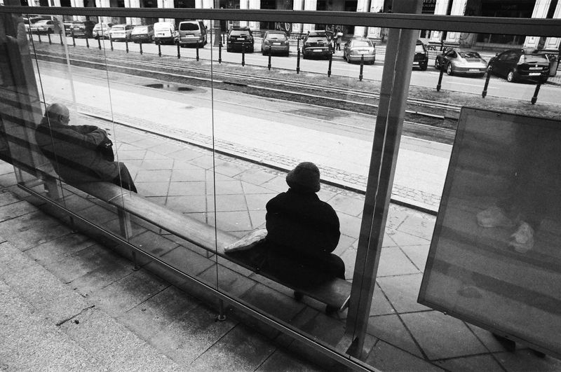 Rollei 400 RPX; Analog in Warsaw The Week on EyeEm Film Photography Analogue Photography Black And White Bnw Monochrome Light And Shadow Capture The Moment Nikonphotography Sitting Men Real People Rear View Indoors  One Person Public Transportation Seat High Angle View Transportation Railroad Station Architecture Rail Transportation Lifestyles Leisure Activity Built Structure Railroad Station Platform Mode Of Transportation Bench Waiting Tiled Floor