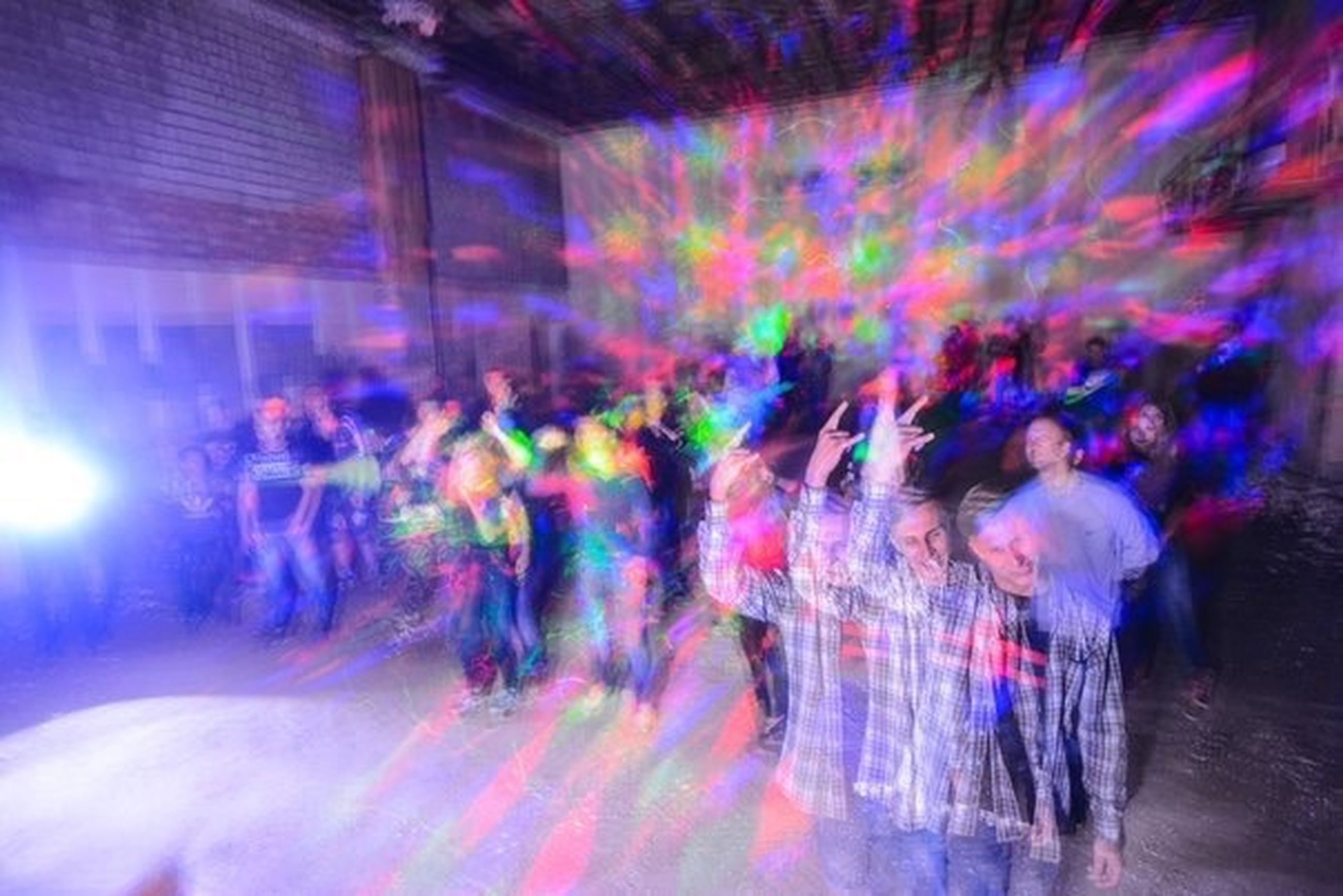 illuminated, night, medium group of people, multi colored, blurred motion, enjoyment, group of people, person, togetherness, nightlife, limb, fun, glowing, party, vibrant color