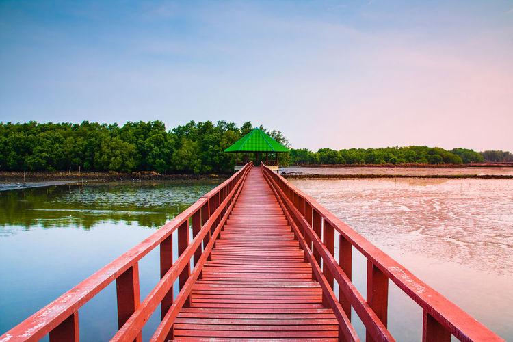 View Of Wooden Bridge Over Calm Lake