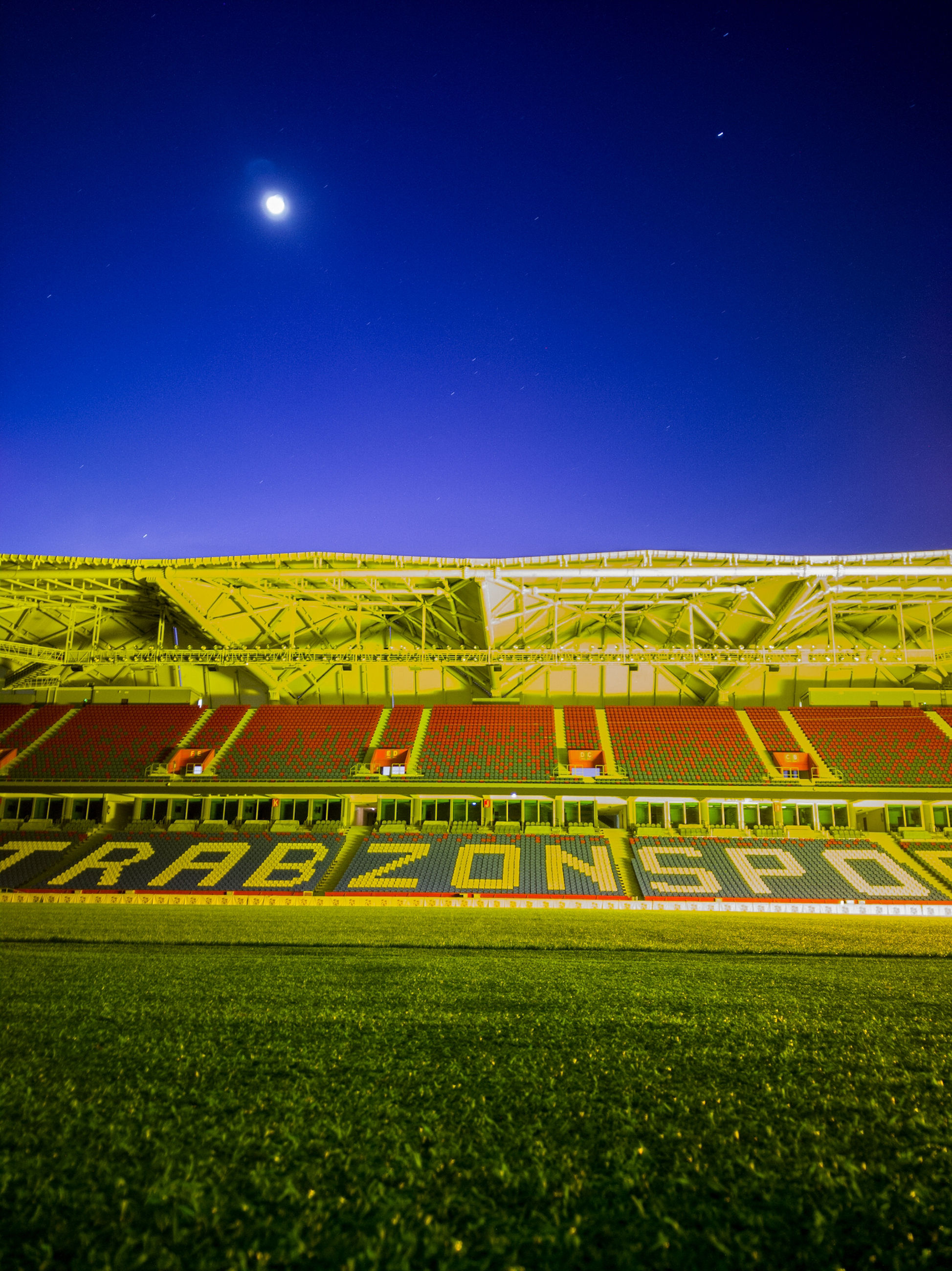 sky, night, grass, blue, field, nature, star - space, no people, land, green color, scenics - nature, landscape, outdoors, stadium, clear sky, environment, beauty in nature, tranquil scene, sport, moon, moonlight