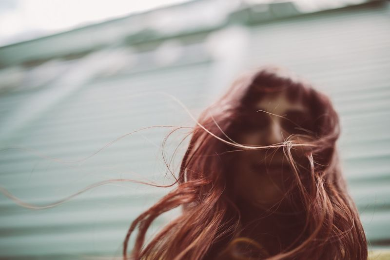 Close-up of redhead woman with messy hair
