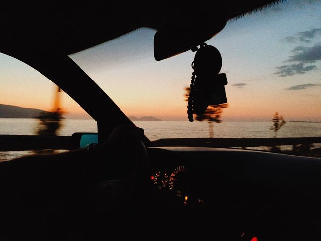 Water Sky Transportation Sunset Nature Silhouette Real People Mode Of Transportation Vehicle Interior One Person Lifestyles Car Windshield Outdoors Motor Vehicle Unrecognizable Person City Land Vehicle Car Interior