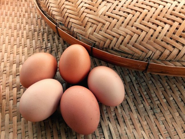 Fresh eggs on the wooden threshing basket background Threshing Basket Bamboo Basket Decoration Arrangement Kitchen EyeEm Selects Egg Food Food And Drink High Angle View Indoors  Healthy Eating Brown No People Egg Carton Day Close-up Freshness