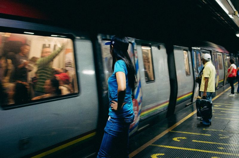 Estilacho Mode Of Transportation Transportation Travel Public Transportation Rail Transportation Real People Train Lifestyles Train - Vehicle Journey People Land Vehicle Passenger Men Railroad Station Window Casual Clothing Leisure Activity Railroad Station Platform Vehicle Interior Subway Train Outdoors Street Photography EyeEm Best Shots EyeEm Selects