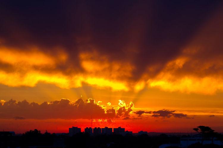 Silhouette Cityscape Against Orange Sky