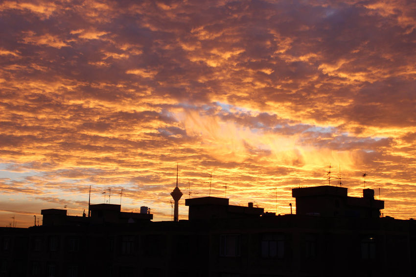 Apartment Architecture Beauty In Nature Building Building Exterior Built Structure City Cloud - Sky Dramatic Sky Low Angle View Nature No People Orange Color Outdoors Overcast Residential District Silhouette Sky Sunlight Sunset