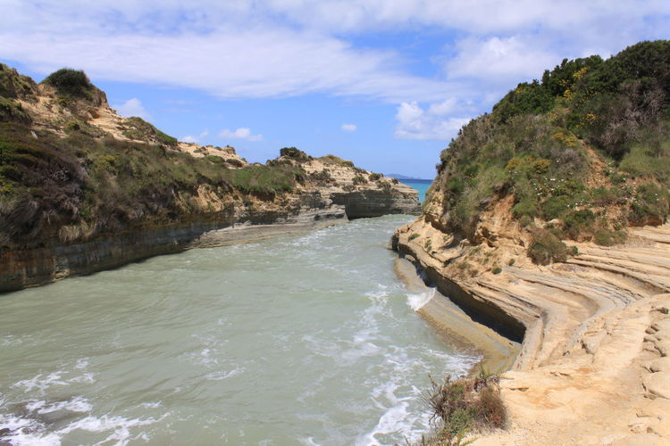 Scenic view of cliffs next to sea