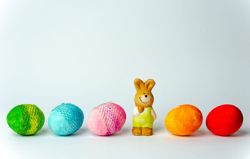 happy Easter White Background Easter Studio Shot Multi Colored Gray Background Easter Bunny Figurine  Easter Egg Eggshell Bauble Extinct Rabbit - Animal Toy Animal Animal Egg