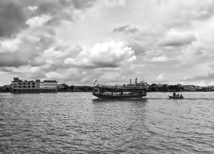 Three Stories IPhoneography Blackandwhite Water Cloud - Sky Nautical Vessel Transportation Sky Waterfront Mode Of Transport Day Outdoors Nature Architecture Built Structure No People Travel Destinations Building Exterior Scenics Beauty In Nature Sailing City