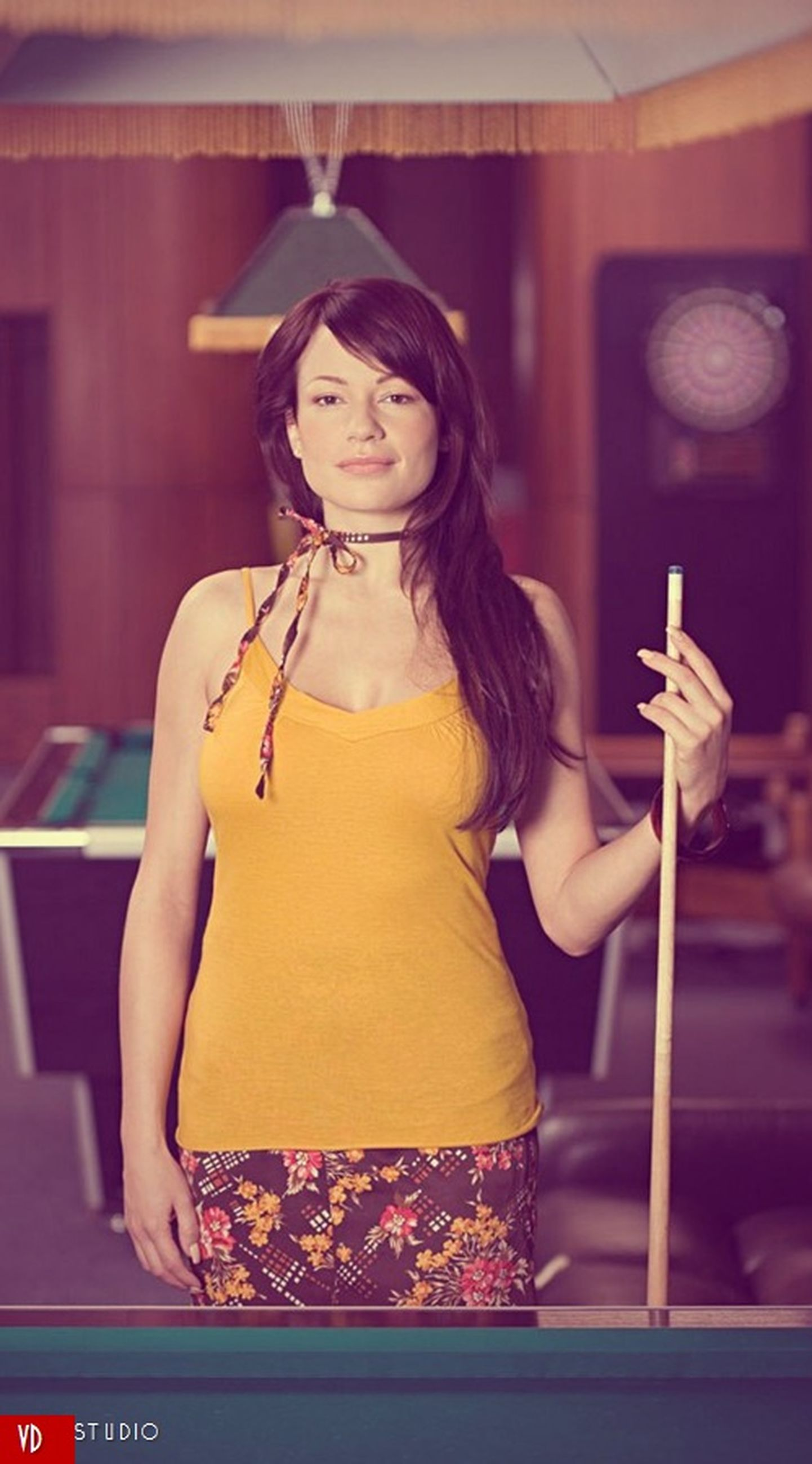 indoors, young adult, person, lifestyles, casual clothing, front view, leisure activity, sitting, young women, holding, three quarter length, human representation, art, waist up, looking at camera, standing, smiling