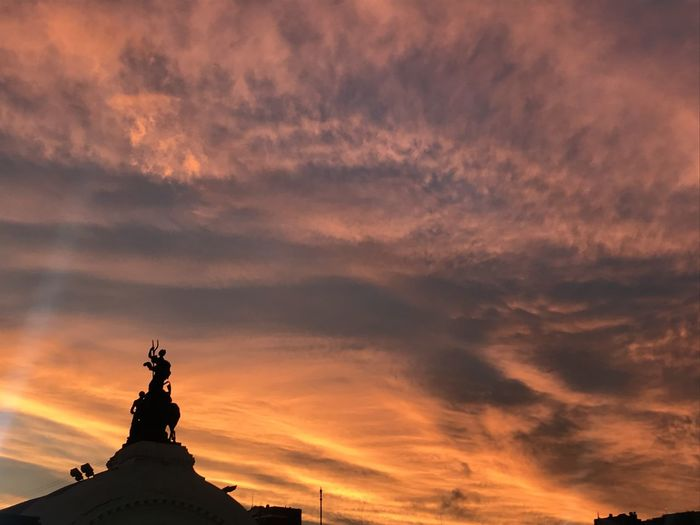 Sky Sunset Cloud - Sky Statue Sculpture Nature Art And Craft Orange Color No People Silhouette Representation Architecture Low Angle View History Human Representation Built Structure Beauty In Nature Religion Scenics - Nature Travel Destinations