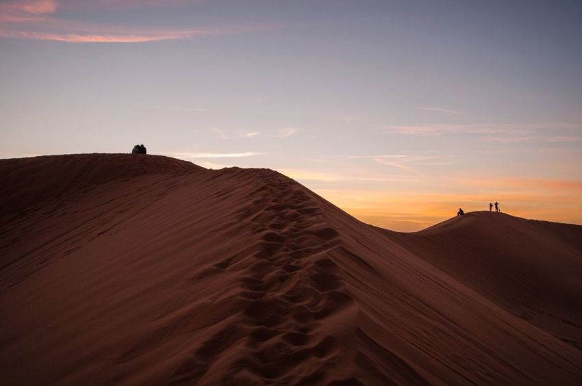 Watching sunset from the top of a Dune! Sunset Open Edit Check This Out Exploring Landscape Silhouette Traveling Morocco The Adventure Handbook Deserts Around The World