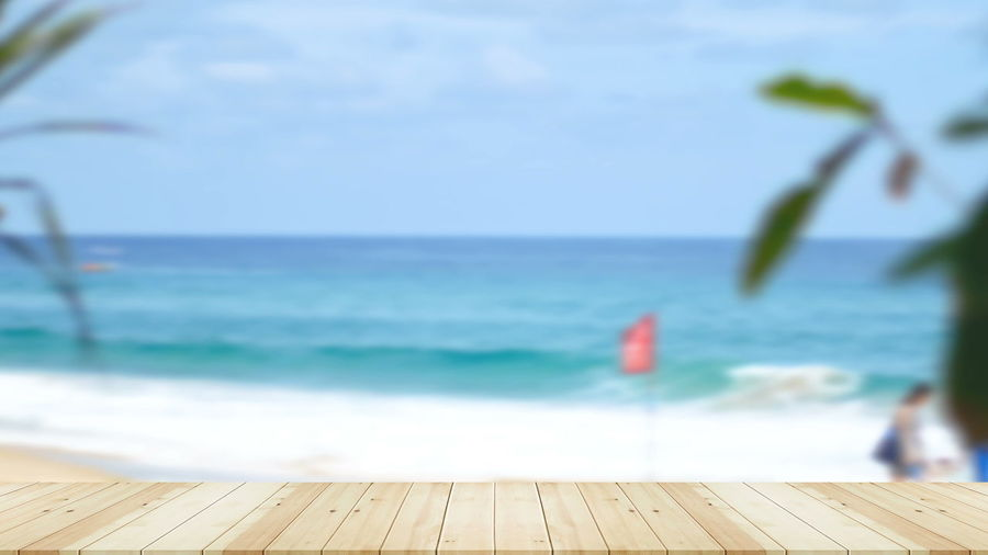 Wood table on beach sea in the summer. Sea Water Horizon Horizon Over Water Sky Beauty In Nature Wood - Material Nature Scenics - Nature Day Focus On Foreground Beach Tranquility Outdoors Motion Land Tranquil Scene No People Blue