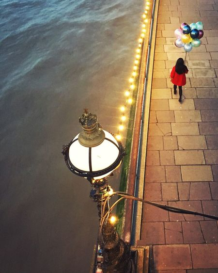Postcode Postcards SE1 Moments. Balloon Girl Real People Outdoors Illuminated One Person Men Full Length Standing Water Day People Women Balloons Thames London Noreleaserequired