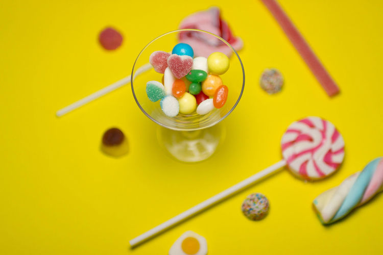 Bowl Candy Colored Background Easter Eating Utensil Food Food And Drink Fruit Healthy Eating High Angle View Indoors  Indulgence Kitchen Utensil Multi Colored No People Spoon Studio Shot Sweet Sweet Food Temptation Yellow Yellow Background