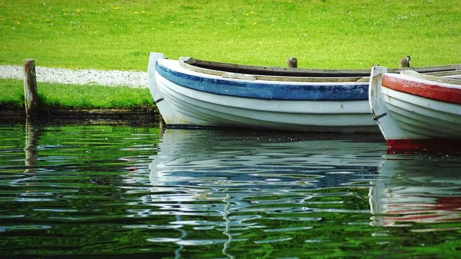 Boats Water Nautical Vessel Transportation Mode Of Transportation Waterfront Moored Nature Day Lake No People Reflection Green Color Outdoors Grass Rowboat Travel