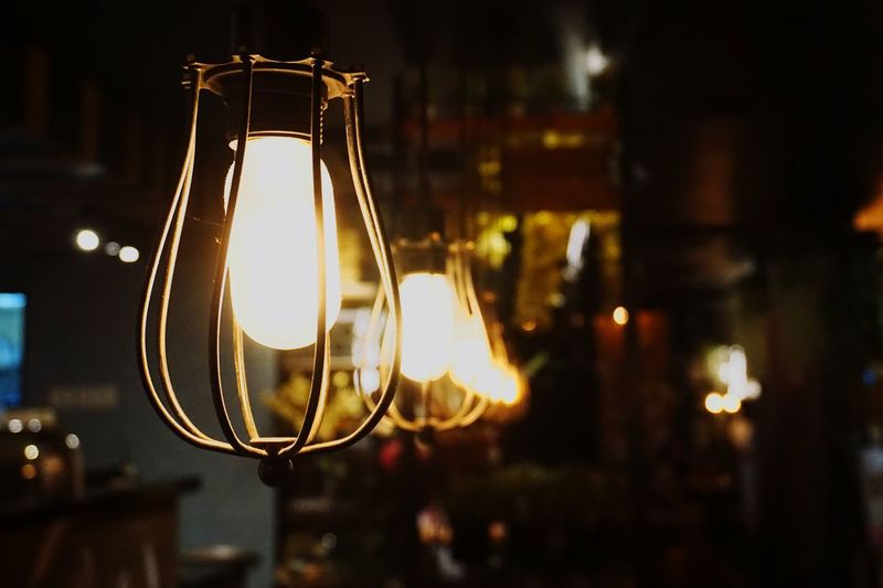 Illuminated Focus On Foreground Hanging Lighting Equipment Light Bulb Night Close-up No People Electricity  Indoors  Filament